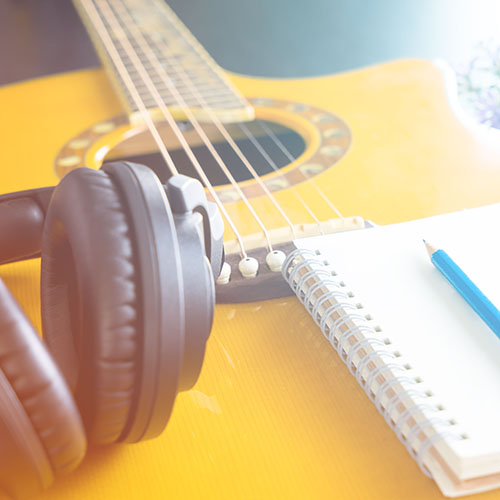 Guitar and Headphone notebook for songwriting
